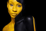 Black and yellow makeup. Cheerful young african woman with art fashion makeup. - 199968241