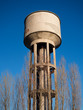 Concrete tower with water cistern.