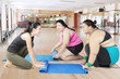 Overweight women and their trainer scrolling mat