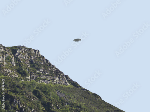 In de dag UFO UFO Sighting, flying saucer in the sky over hills on summers day, metal flying spacecraft