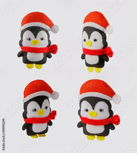 Fotobehang Pinguin hand toy penguin. Christmas decoration of deer. Soft toy