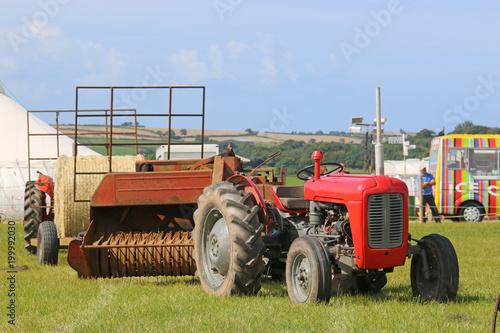 Fotobehang Trekker Vintage tractor pulling a baler