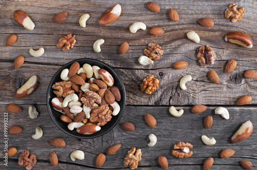 Mixed nuts on wooden background