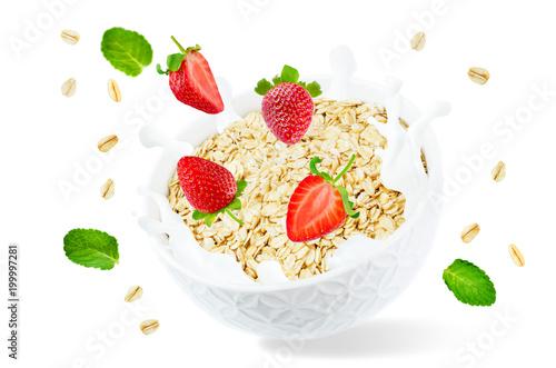 Foto Murales Oat bowl with splash of milk and flying strawberries