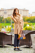 Portrait of a young beautiful woman in beige coat