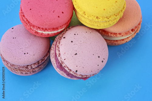 Fotobehang Macarons Sweet and colorful French macarons on blue background