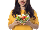 Portrait of  beautiful asian young  woman eating vegetable salad Isolated on white background.
