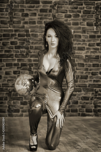girl in a tight suit with a disco ball, sepia - 200042084