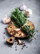 Fresh rosemary on a vintage wooden board - 200053427