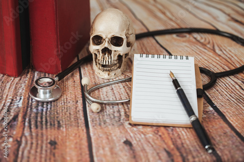 Foto Murales skull with old text book ,concept with medical education .