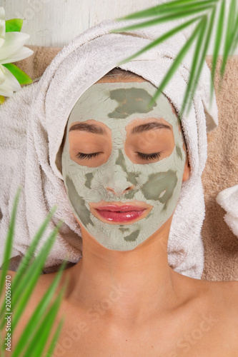Foto Murales Young healthy woman with face mask.
