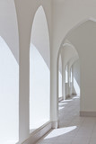 empty abstract light interior corridor background with arches and sunlight - 200060055