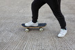 Kid skateboarder doing a skateboard ride.