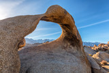 Mobius Arch on sunset with Whitney mountain on background. Alabama Hills, Eastern Sierra Nevada Mountains, Lone Pine, California, USA. - 200066480