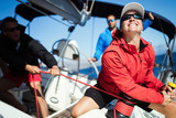 Attractive strong woman sailing with her boat - 200067877