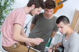 young men composing music one playing guitar - 200072079