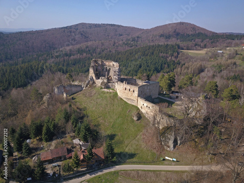 Foto op Aluminium Cappuccino Kamenets, near Odjykon, Poland -april 8, 2018: Ancient ruins of a medieval castle against the backdrop of a natural landscape of the central strip of central Europe. View of drone. Panorama of fly.