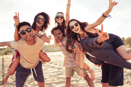 Happy cheerful young loving couples friends