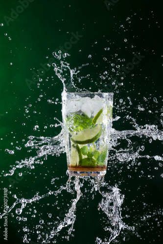 fresh mojito drink with liquid splash and crushed ice in freeze motion. - 200073898