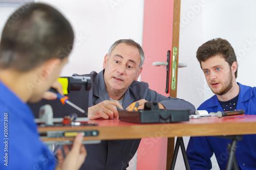 teacher with student fitting door lock Poster