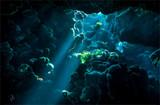 Underwater cave sunbeam scene