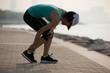 Woman runner hold er sports injured knee