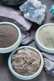 Ancient nature minerals, different types of clay used for skincare, spa treatments, face masks, gray, black, green and blue mud, close up