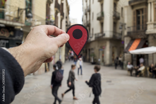 man with a red marker in a European city