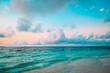 tropical sand beach at sunset