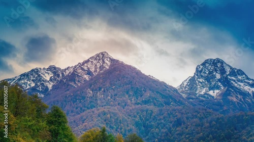 Cinemagraph of an autumn mountain scene zooming in to a cloudscape forming over the ridgline