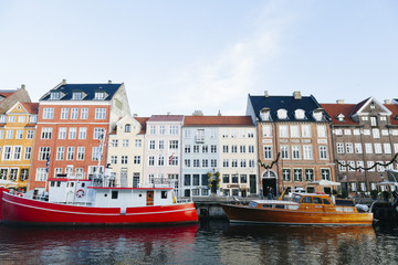 Colorful boats and old city buildings