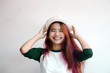 pretty asian femele smiling joyfully with colorful hair in dressed casually like hipster lifestyle,