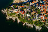 Aerial view the city of Kavala in northern Greek, ancient aqueduct Kamares, homes and medieval city wall - 200117827