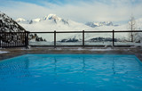 Outdoor pool and mountain slopes in the Alps in France