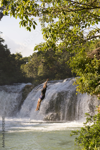 Adventure Traveller Jumping Off Waterfall In Belize - 200128085