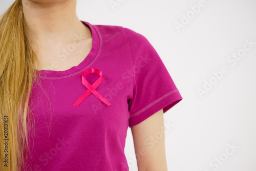 Woman having pink breast cancer ribbon on tshirt