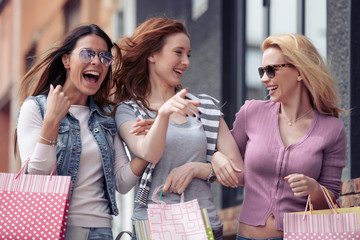Young attractive girls with shopping bags in the city
