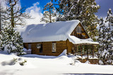 Remote Cabin With Snow Piled High On Roof - 200133896