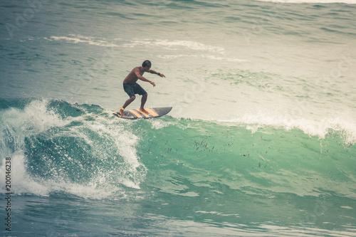Fototapeta Surfer on Blue Ocean Wave, Bali, Indonesia. Riding in tube.