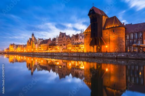 Foto op Plexiglas Schip Historic port crane in Gdansk reflected in Motlawa river at dusk, Poland