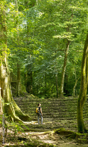 Woman Exploring Jungle Ruins