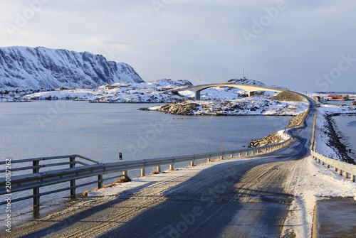 famous fredvang bridges in winter sunset with mountains in backgrond and beautiful shadow line in foreground , lofoten islands, norway - 200157262