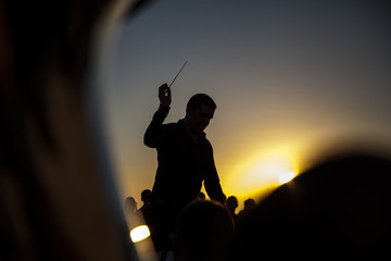 Philharmonic orchestra concert at sunset