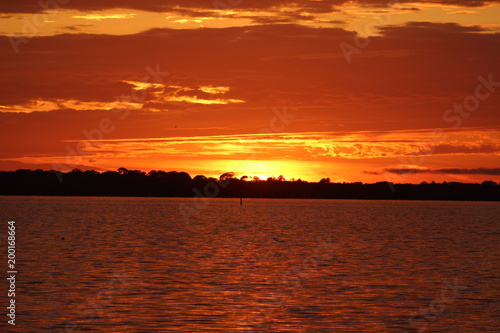 Foto op Plexiglas Rood paars Vibrant dramatic orange sunset sky with cloudscape