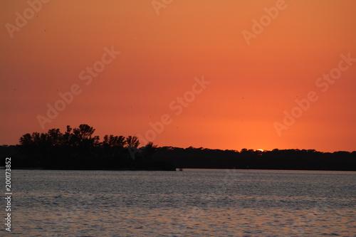 Fotobehang Baksteen Orange sky after the sun is below the horizon