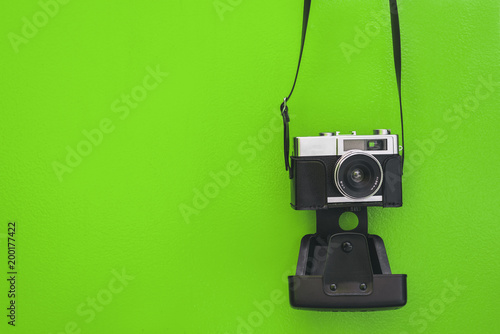 Vintage camera isolated at green wall - 200177422