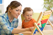 mother and baby son playing with abacus, early education - 200192058