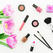 Leinwanddruck Bild Composition with pink tulips bouquet and cosmetics on white background. Top view. Flat lay. Home feminine desk.