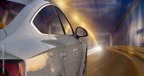 modern sports car going at night in a lighted tunnel