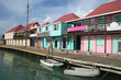 The harbour with colourful houses along the water's edge, St John, Antigua, Caribbean.